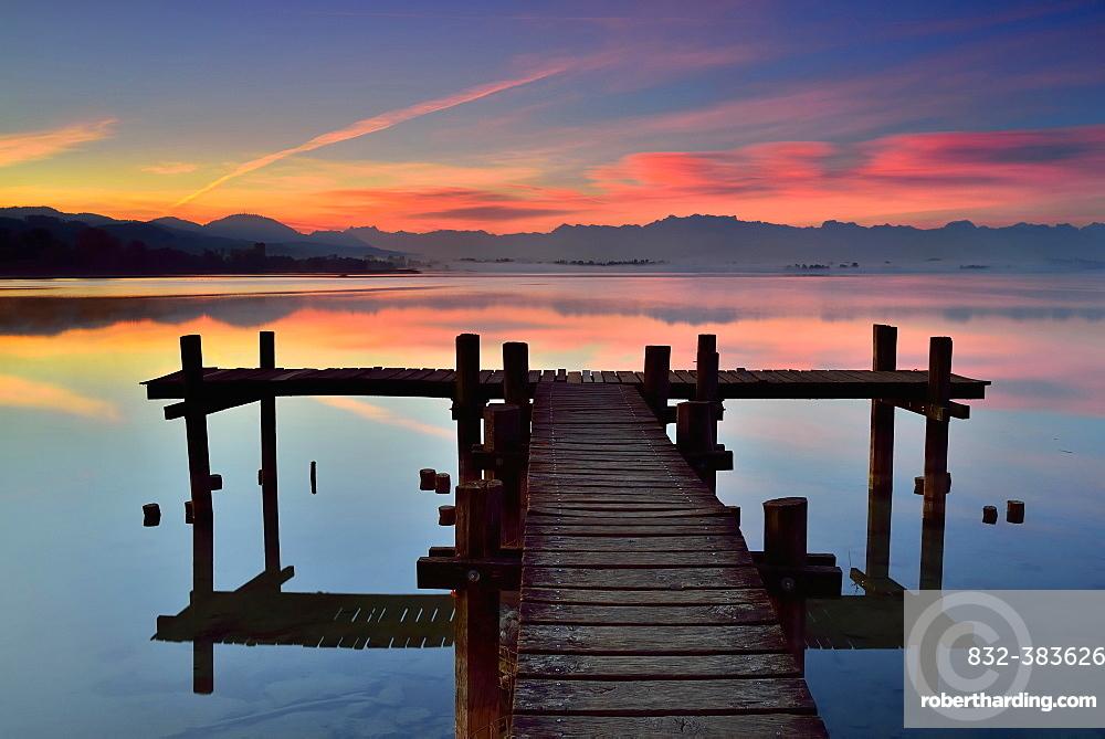Wooden foodbridge at the Lake Pfaffikersee at dawn, Pfaffikon, Canton Zurich, Switzerland, Europe