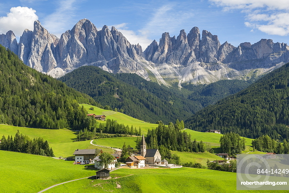 View of Church and mountain backdrop, Val di Funes, Bolzano Province, Trentino-Alto Adige/South Tyrol, Italian Dolomites, Italy, Europe
