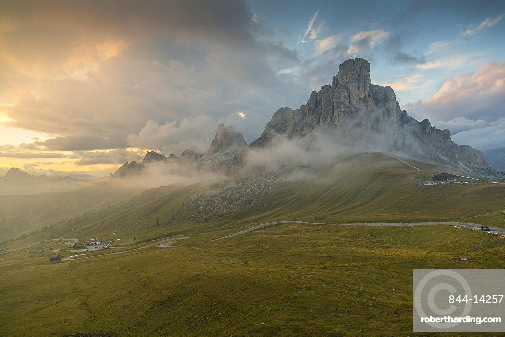 View of landscape and winding road from Marmolada Pass at sunset, South Tyrol, Italian Dolomites, Italy, Europe