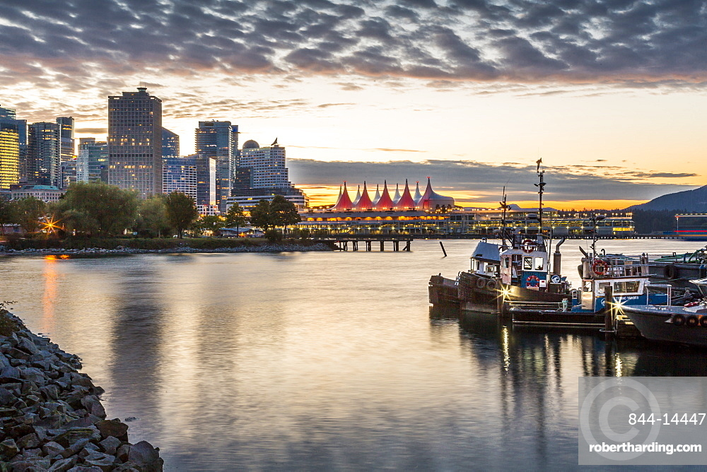 View of Canada Place and urban office buildings at sunset from CRAB Park, Vancouver, British Columbia, Canada, North America
