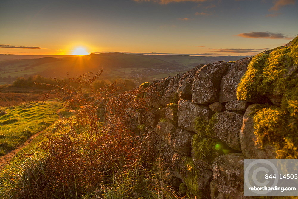 View of sunset from dry stone wall on Baslow Edge, Baslow, Peak District National Park, Derbyshire, England, United Kingdom, Europe