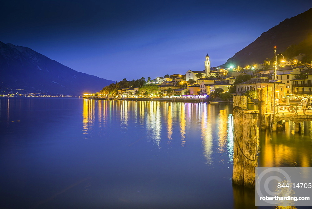 Panoramic view of Lake Garda and the port of Limone at dusk, Lake Garda, Lombardy, Italy, Europe