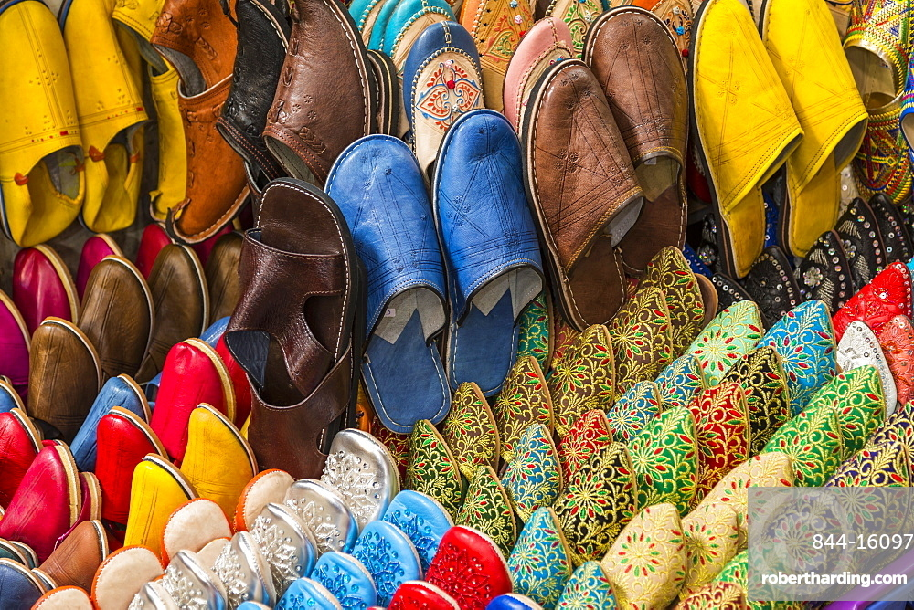 Colourful souvenir shoes for sale in the Market At Rahba Qedima, Marrakesh (Marrakech), Morocco, North Africa, Africa