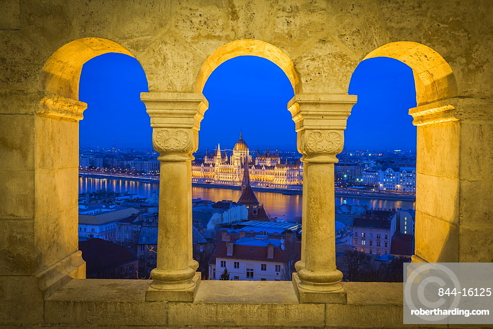 View of Parliament Buikding from Fisherman's Bastion at dusk, Buda Castle Hill, Budapest, Hungary, Europe