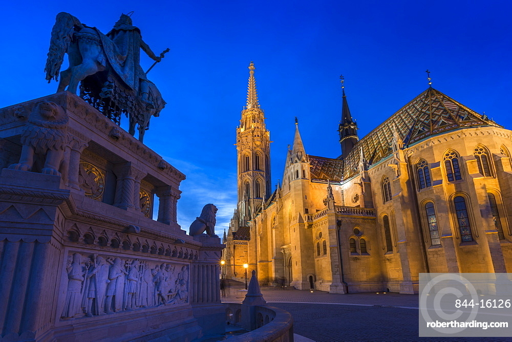 Statue of King Stephen I and Matthias Church at dusk, Fishermans Bastion, Budapest, Hungary, Europe