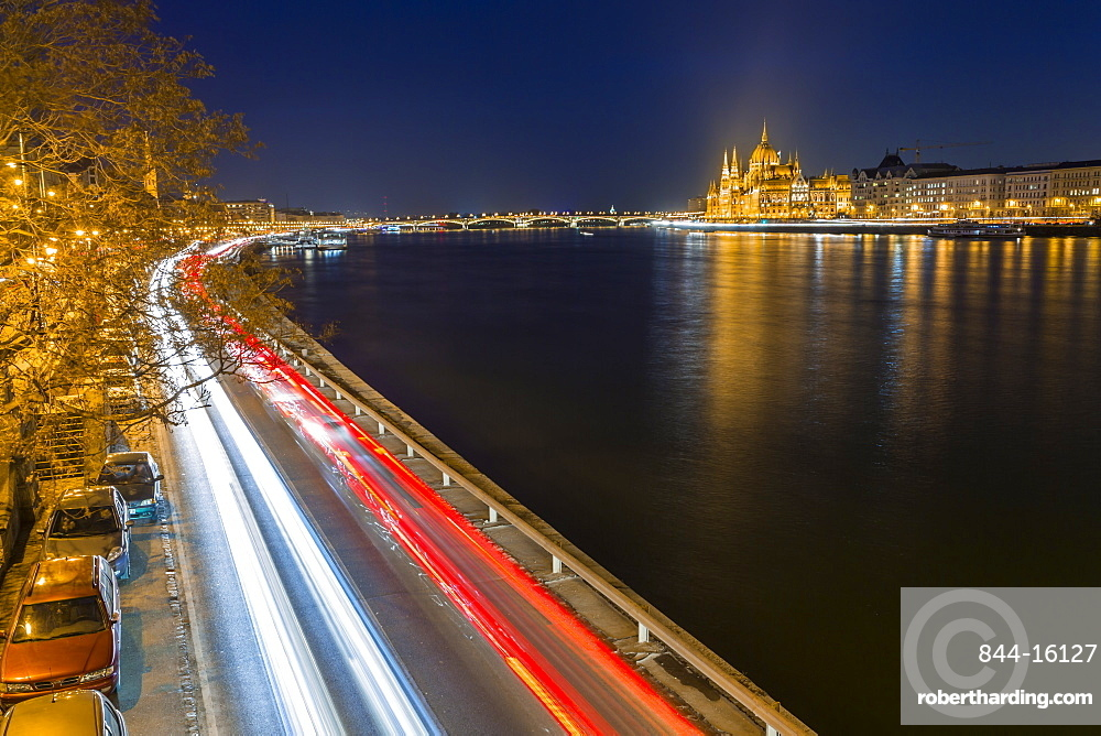 Trail lights along River Danube and Hungarian Parliament Building at night, Budapest, Hungary, Europe