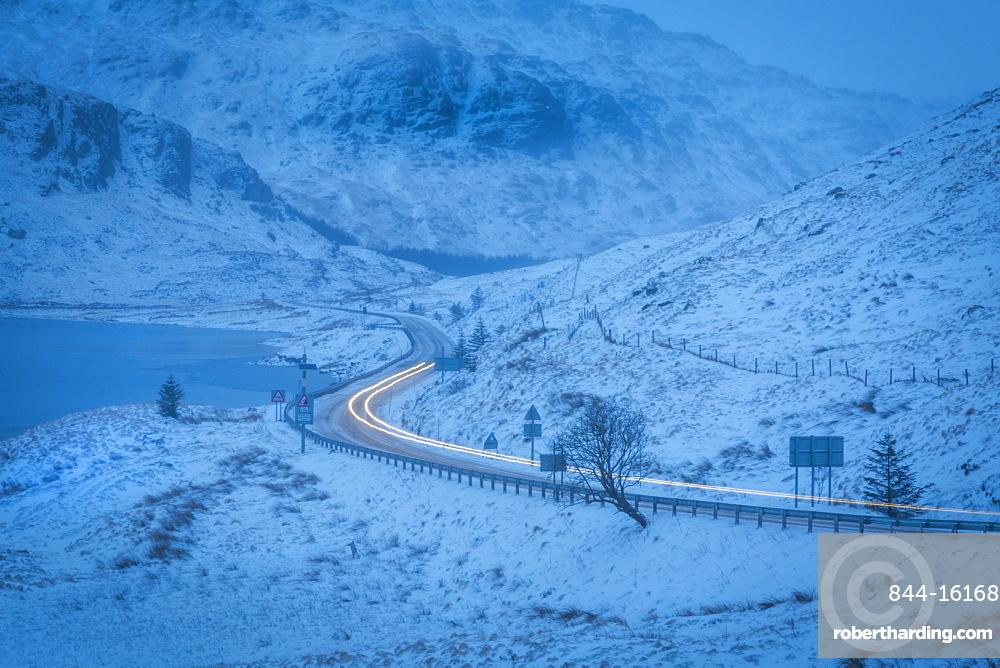 Scottish Highland road near Arrochar village in winter in the Loch Lomond and the Trossachs National Park, Stirling, Scotland, United Kingdom, Europe