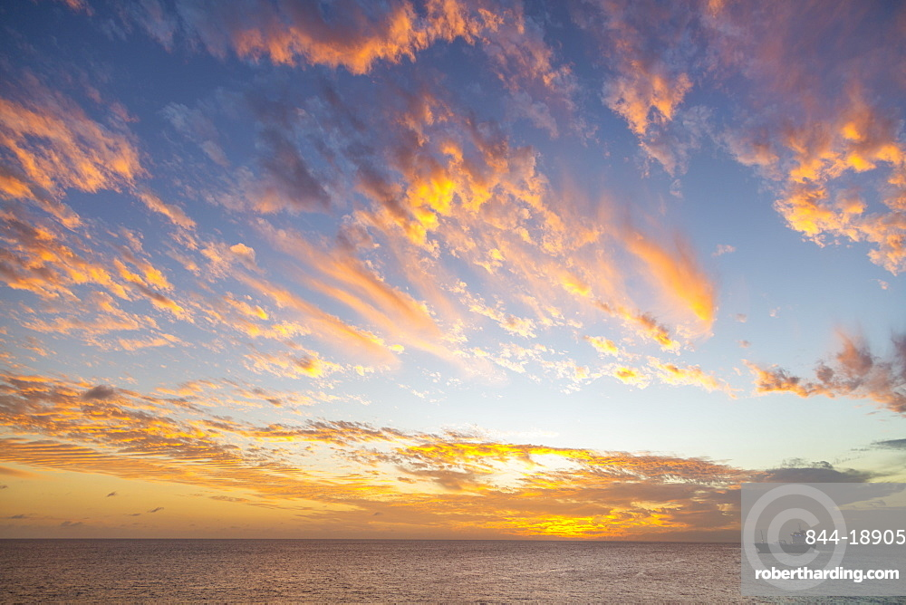 View of ship against West Coast sunset, Bridgetown, Barbados, West Indies, Caribbean, Central America