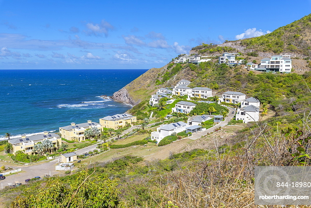 View of Kittian Village and Caribbean Sea, St. Kitts and Nevis, West Indies, Caribbean, Central America
