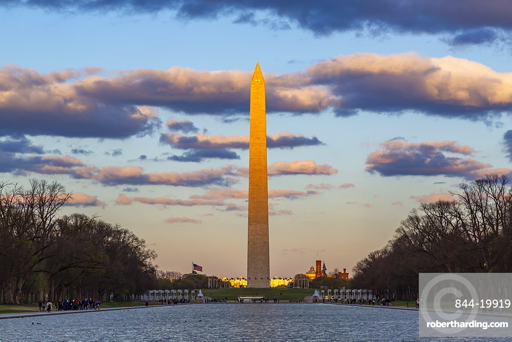 View of Lincoln Memorial Reflecting Pool and Washington Monument at sunset, Washington DC, District of Columbia, United States of America
