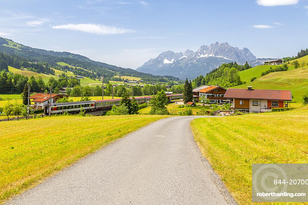 View of trainline and Ellmauer Halt Mountain peak near St Johann, Austrian Alps, Tyrol, Austria, Europe