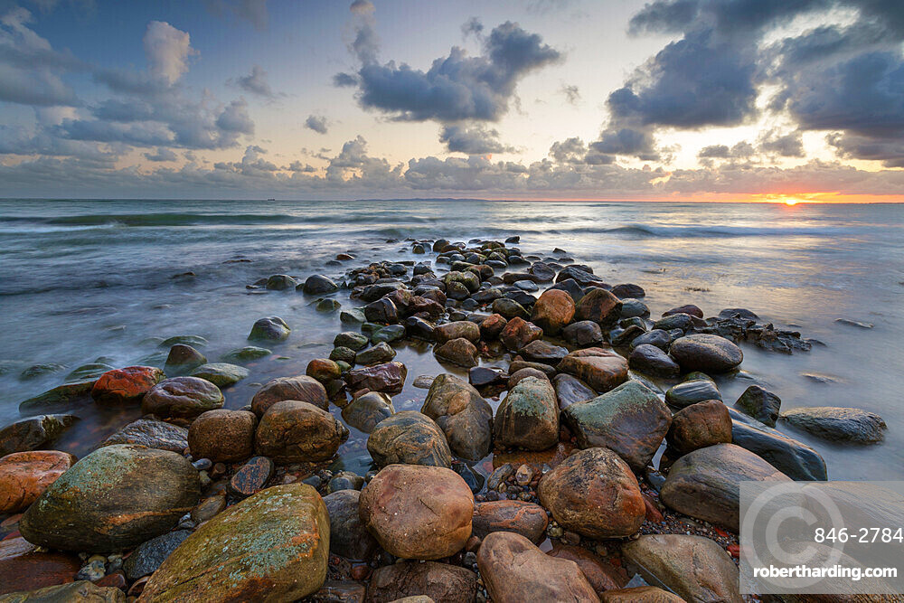 Rock breakwater in sea at sunrise, Munkerup, Kattegat Coast, Zealand, Denmark, Scandinavia, Europe
