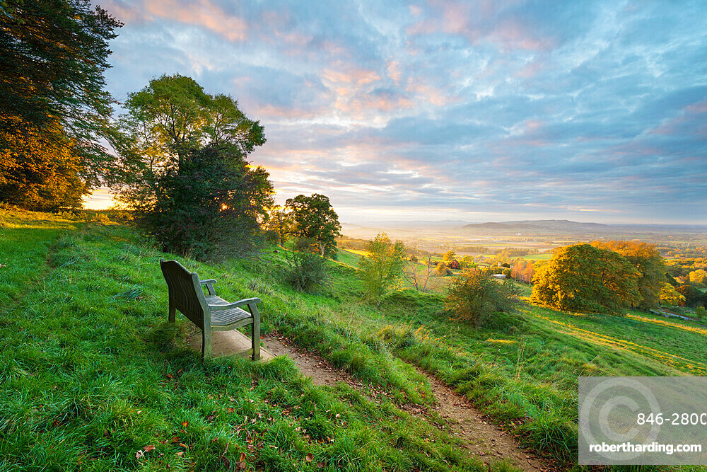 Cotswold Way path and bench with views to the Malvern Hills at sunset, Ford, Cotswolds, Gloucestershire, England, United Kingdom