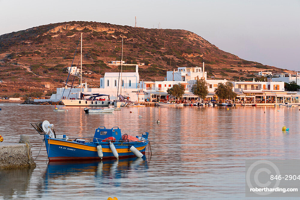 Fishing boat in harbour with town behind, Pollonia, Milos, Cyclades, Aegean Sea, Greek Islands, Greece, Europe
