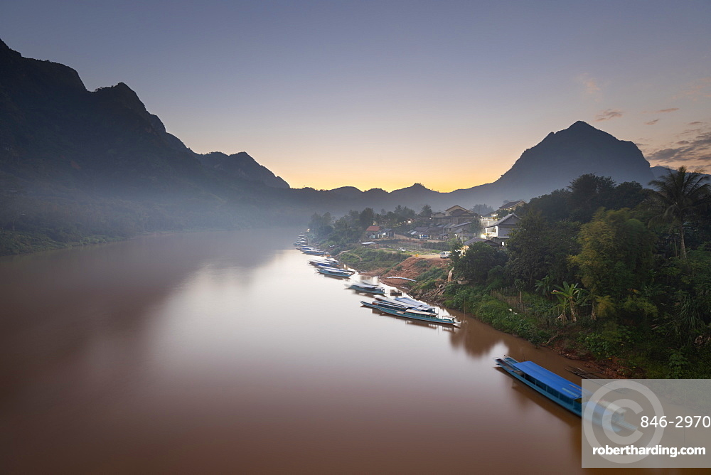 Sunset over the misty Nam Ou River at the village of Nong Khiaw, Luang Prabang Province, Northern Laos, Laos, Southeast Asia