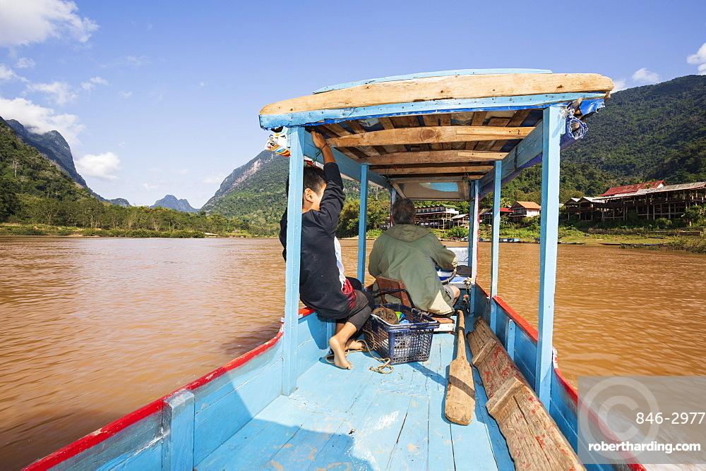 Boat trip on the Nam Ou River looking north at Muang Ngoi Neua, Luang Prabang Province, Northern Laos, Laos, Southeast Asia