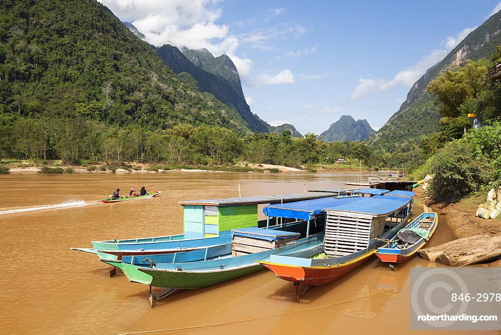 Boats docked on the Nam Ou River at Muang Ngoi Neua looking north, Luang Prabang Province, Northern Laos, Laos, Southeast Asia