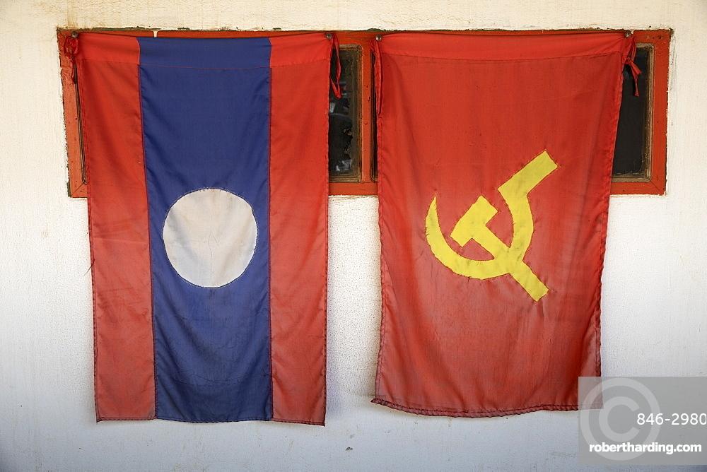 Laos national and Lao People's Revolutionary Party (LPRP) flags, Nong Khiaw, Northern Laos, Laos, Southeast Asia