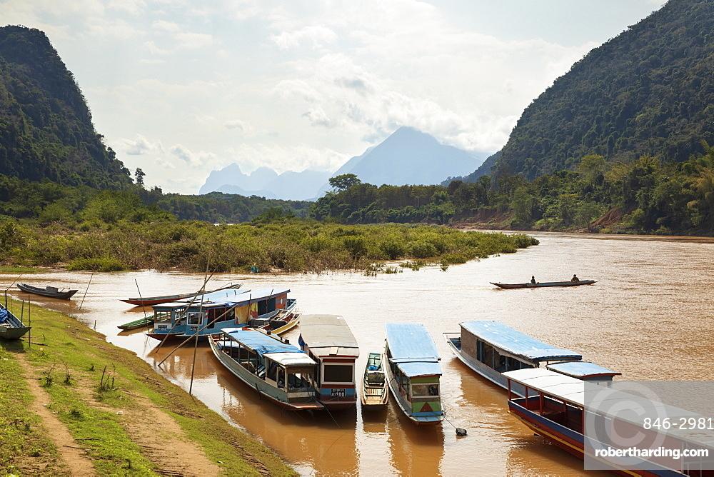 Boats on the Nam Ou River at Muang Ngoi Neua, Muang Ngoi District, Luang Prabang Province, Northern Laos, Laos, Southeast Asia