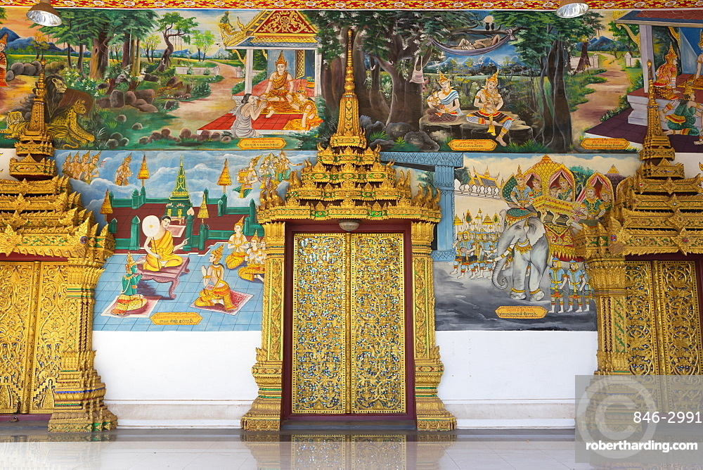 Murals and golden doors at the entrance of the Wat Inpeng buddhist temple, Rue Samsenthai, Vientiane, Laos, Southeast Asia