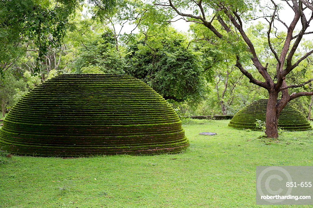 A moss covered dagoba dome in the Kiri Vihara temple ruins at Polonnaruwa, a UNESCO World Heritage Site in Sri Lanka