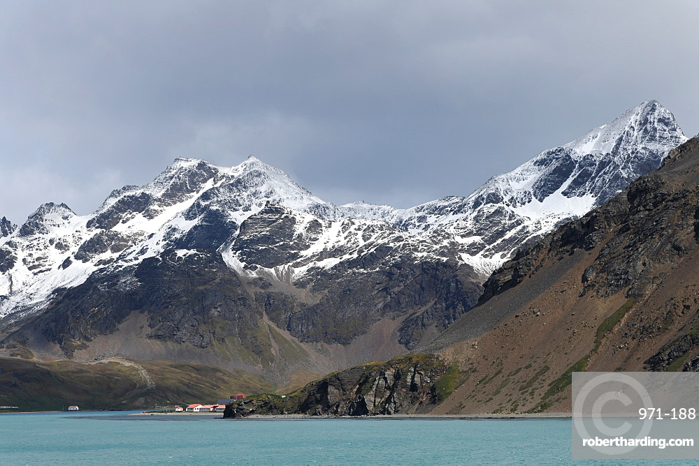 King Edward Point research station at the foot of the snow covered Allardyce Range