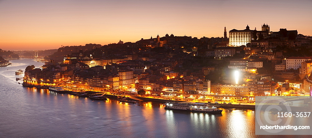 View over Douro River at sunset to Ribeira District, UNESCO World Heritage Site, Porto (Oporto), Portugal, Europe