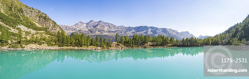 Panoramic of turquoise Lago Lagazzuolo, Chiesa In Valmalenco, Province of Sondrio, Valtellina, Lombardy, Italy, Europe (Drone)
