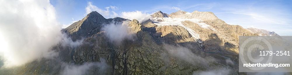 Panoramic of Piz Arlas, Cambrena, Caral at dawn Bernina Pass, Poschiavo Valley, Engadine, Canton of Graubunden, Switzerland, Europe (Drone)