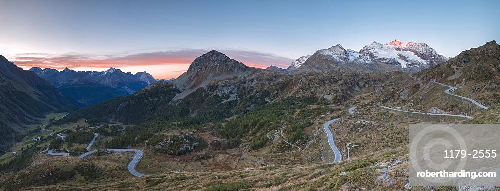 Panoramic of the road bends of Bernina Pass at dawn, Poschiavo Valley, Engadine, Canton of Graubunden, Switzerland, Europe