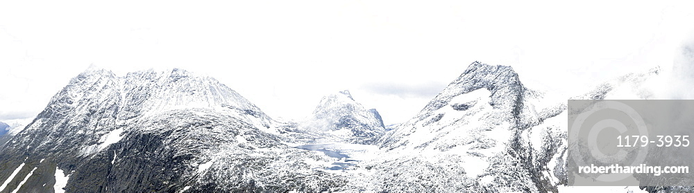 Aerial panoramic of Store Venjetinden & Olaskarstinden mountains covered with snow, Venjesdalen valley, Romsdalen, Rauma, Norway