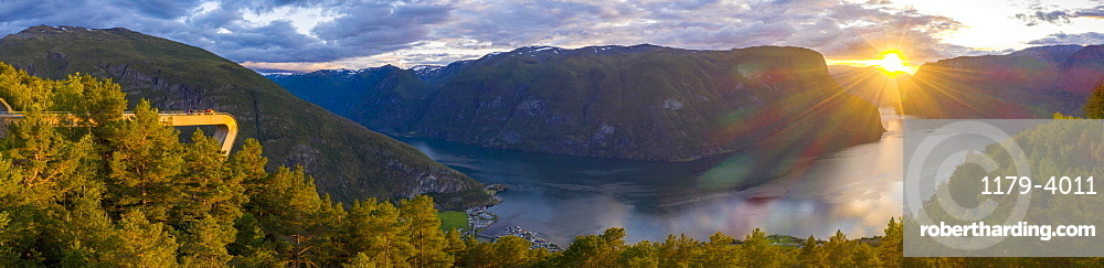 Aerial panoramic of sunset over Stegastein viewpoint above Aurlandsfjord, Sogn og Fjordane county, Norway (drone)
