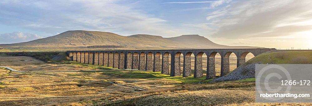 View to Ingleborough and the 24 arches of Ribblehead Viaduct on the Settle to Carlisle line, Yorkshire Dales, North Yorkshire