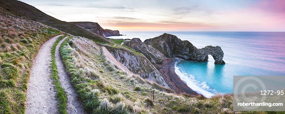 Durdle Door at sunrise, Lulworth Cove, Jurassic Coast, UNESCO World Heritage Site, Dorset, England, United Kingdom, Europe