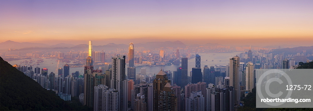 Hong Kong skyline at sunset, with a beautiful view of the Central CBD, Victoria Harbour, Kowloon cityscape, Hong Kong, China, Asia