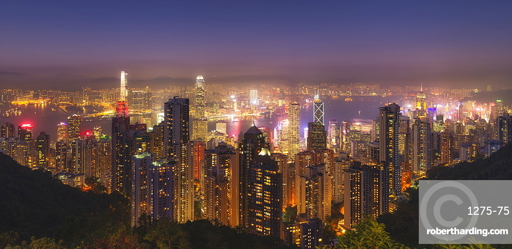 Hong Kong city skyline at night, showing the central and Kowloon area, viewed from the Victoria Peak