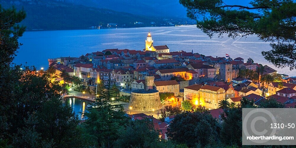 View over the Old Town at dusk, the illuminated cathedral prominent, Korcula Town, Korcula, Dubrovnik-Neretva, Dalmatia, Croatia, Europe