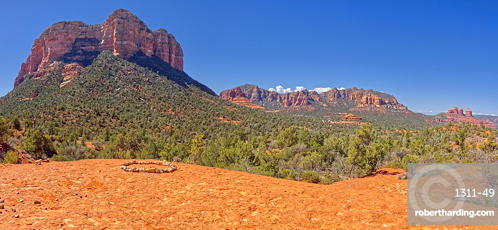 Panorama view of Courthouse Butte and Cathedral Rock from a sandstone terrace off of Llama Trail in Sedona AZ.