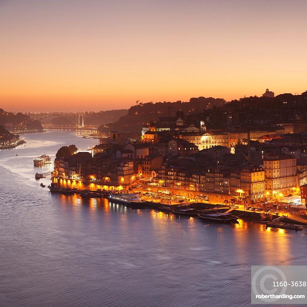 View over Douro River at sunset to Ribeira District, UNESCO Wolrd Heritage Site, Porto, Oporto, Portugal