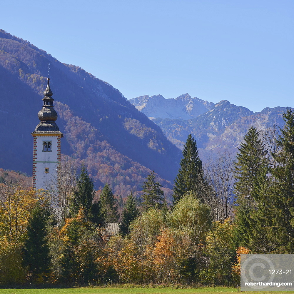 Church of St. John The Baptist with Triglav mountains in the background, Triglav National Park, Slovenia, Europe