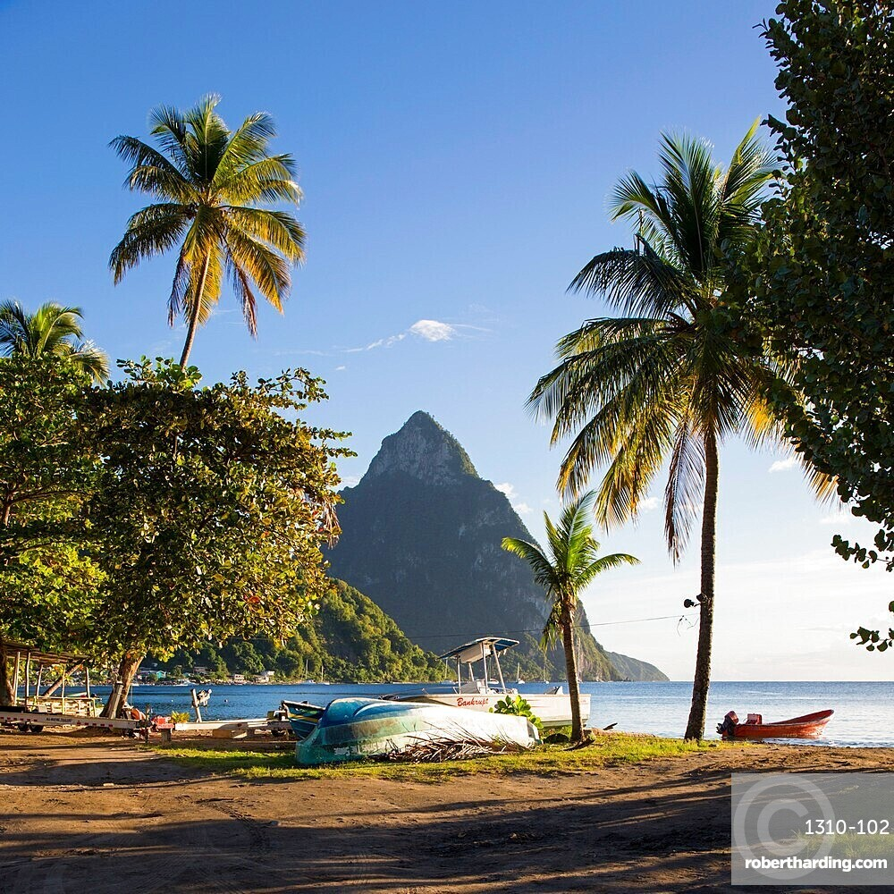 View from palm-fringed beach across Soufriere Bay to Petit Piton, evening, Soufriere, St Lucia, Lesser Antilles, West Indies