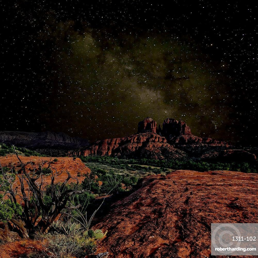 A composite image of Cathedral Rock in Sedona AZ under the starlight of the Milky Way.