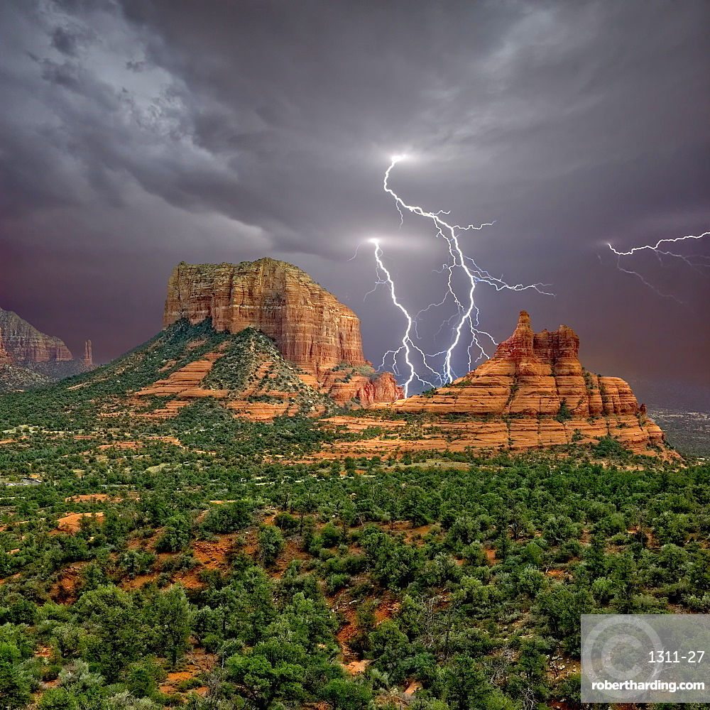 Lightning striking in between Courthouse Butte and Bell Rock near Sedona, Arizona, United States of America, North America
