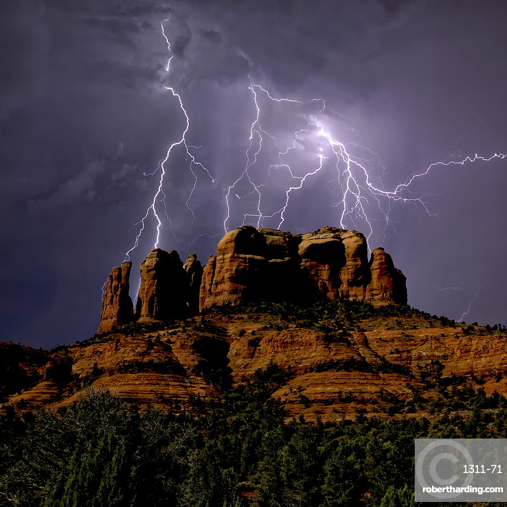 Composite photo of lightning striking southwest of Cathedral Rock in Sedona AZ.
