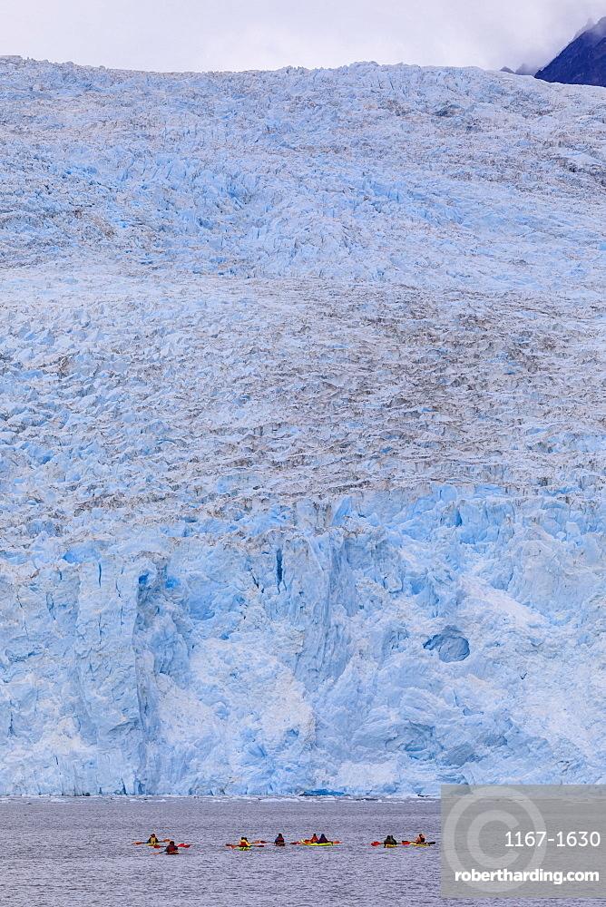 Colourful kayaks, Aialik Glacier, blue ice, Harding Icefield, Kenai Fjords National Park, near Seward, Alaska, United States of America, North America