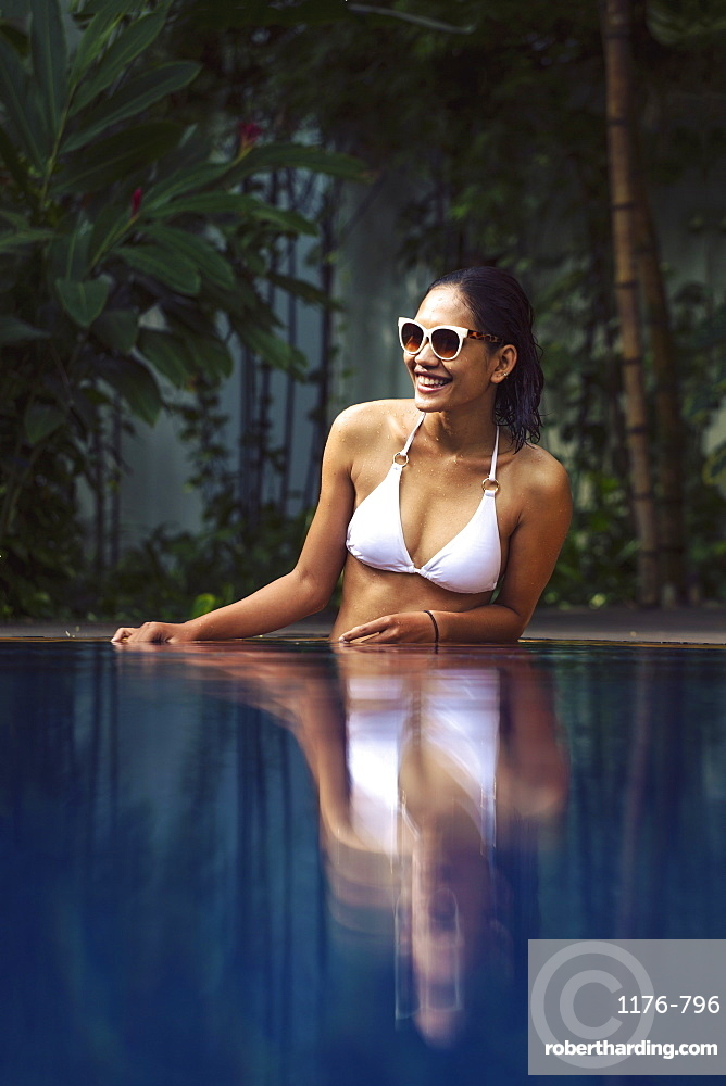 Young South East Asian woman in a white bikini in a swimming pool, Cambodia, Southeast Asia, Asia