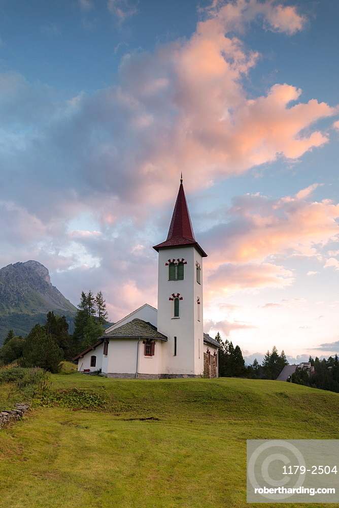 Clouds at sunset on Chiesa Bianca, Maloja, Bregaglia Valley, Engadine, Canton of Graubunden, Swiss Alps, Switzerland, Europe