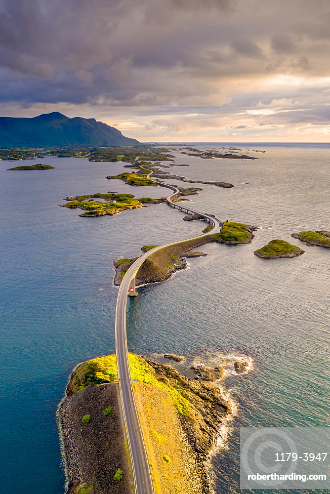 Sunset over Storseisundet Bridge view from above, Atlantic Road, More og Romsdal county, Norway (drone)