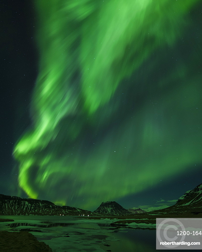 Aurora borealis and partially frozen lake, North Snaefellsnes, Iceland.