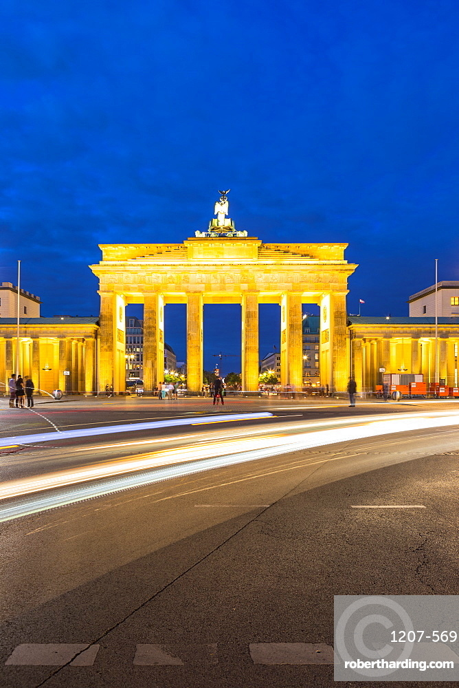 Light trails by Brandenburg Gate at night in Berlin, Germany, Europe